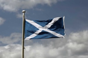 A St. Andrew's or Saltire flag, the national flag of Scotland, flies from a flagpole in Edinburgh, U.K., on Saturday, Aug. 9, 2014. Scottish First Minister Alex Salmond said nothing will stop an independent Scotland from using the pound and dismissed U.K. opposition to a currency union ahead of a vote on the country's future. Photographer: Simon Dawson/Bloomberg via Getty Images
